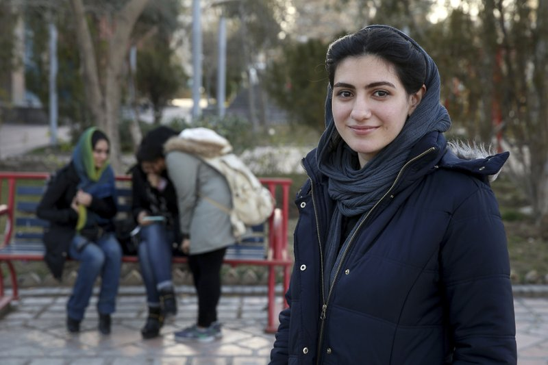 In this Tuesday, Jan. 29, 2019 photo, Kimia Zakeri, a 20-year-old graphic design student, is interviewed by The Associated Press about Iran's 1979 Islamic Revolution, at a park in downtown Tehran, Iran. (AP Photo/Ebrahim Noroozi)