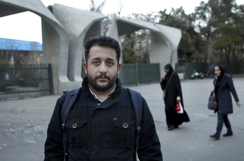 In this Tuesday, Jan. 29, 2019 photo, Shayan Momeni, a 27-year-old dentistry student, is interviewed by The Associated Press about Iran's 1979 Islamic Revolution, in downtown Tehran, Iran. (AP Photo/Ebrahim Noroozi)