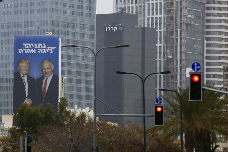 In this Wednesday, Feb. 6, 2019 photo, an election campaign billboard shows Israeli Prime Minister Benjamin Netanyahu, and US President Donald Trump in Tel Aviv, Israel. (AP Photo/Ariel Schalit)