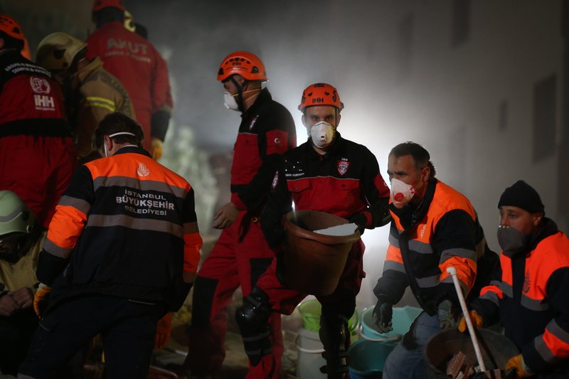 Rescue workers search for survivors at the rubble of an eight-story building which collapsed in Istanbul, late Wednesday, Feb. (AP Photo/ Emrah Gurel)