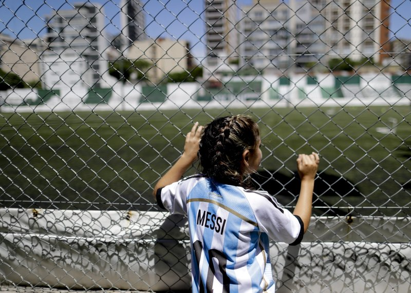 In this Jan. 31, 2019 photo, 12-year-old Candelabra Villegas poses for a photo wearingLionel Messi's national team jersey, in Buenos Aires, Argentina. (AP Photo/Natacha Pisarenko)