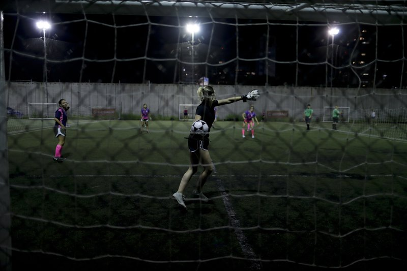 In this Jan. 30, 2019 photo, a goalkeeper throws the ball during a match in Buenos Aires, Argentina. Men's soccer has been a professional sport in Argentina since 1931, and yet, 88 years later, women's soccer is still amateur. (AP Photo/Natacha Pisarenko)