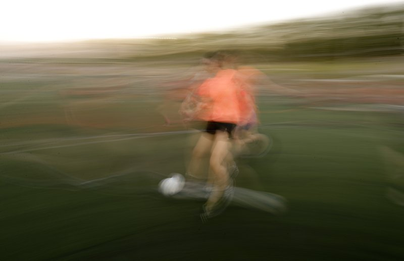 In this Jan. 30, 2019 photo, a woman plays in a soccer match in Buenos Aires, Argentina. Men's soccer has been a professional sport in Argentina since 1931, and yet, 88 years later, women's soccer is still amateur. (AP Photo/Natacha Pisarenko)