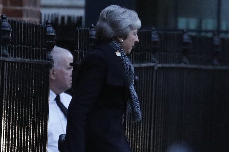 Britain's Prime Minister Theresa May leaves 10 Downing Street, in London, Thursday, Feb. 7, 2019, travelling to join an EU meeting in Brussels. (AP Photo/Frank Augstein)
