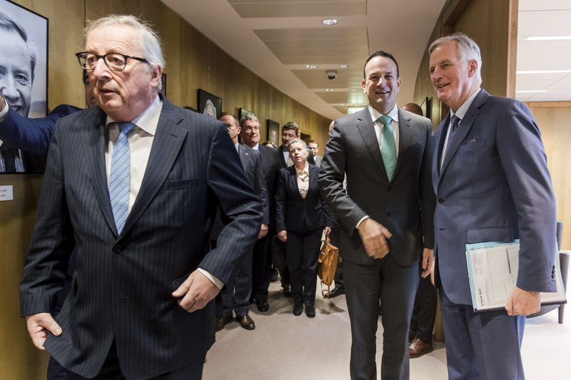 Irish Prime Minister Leo Varadkar, center, greets European Union chief Brexit negotiator Michel Barnier, right, as European Commission President Jean-Claude Juncker, left, walks by before their meeting at the European Commission headquarters in Brussels, Wednesday, Feb. (AP Photo/Geert Vanden Wijngaert, pool)