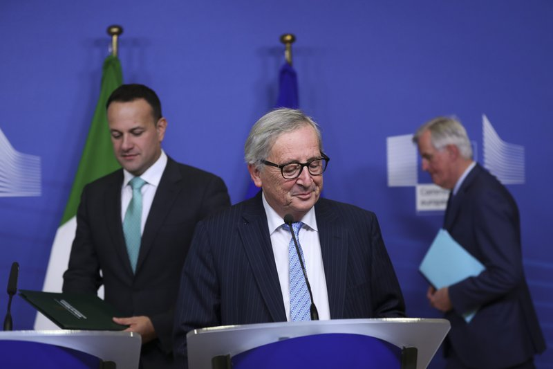 Irish Prime Minister Leo Varadkar, left, European Commission President Jean-Claude Juncker, centre, and European Union chief Brexit negotiator Michel Barnier, background right, arrive for a news conference at the European Commission headquarters in Brussels, Wednesday, Feb. (AP Photo/Francisco Seco)