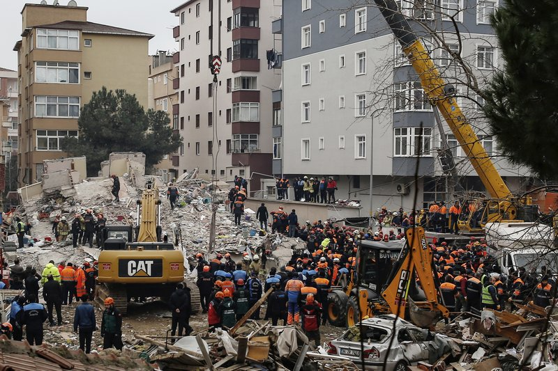 Rescue workers try to remove rubble from an eight-storey building which collapsed a day earlier in Istanbul, Thursday, Feb. (AP Photo/Emrah Gurel)
