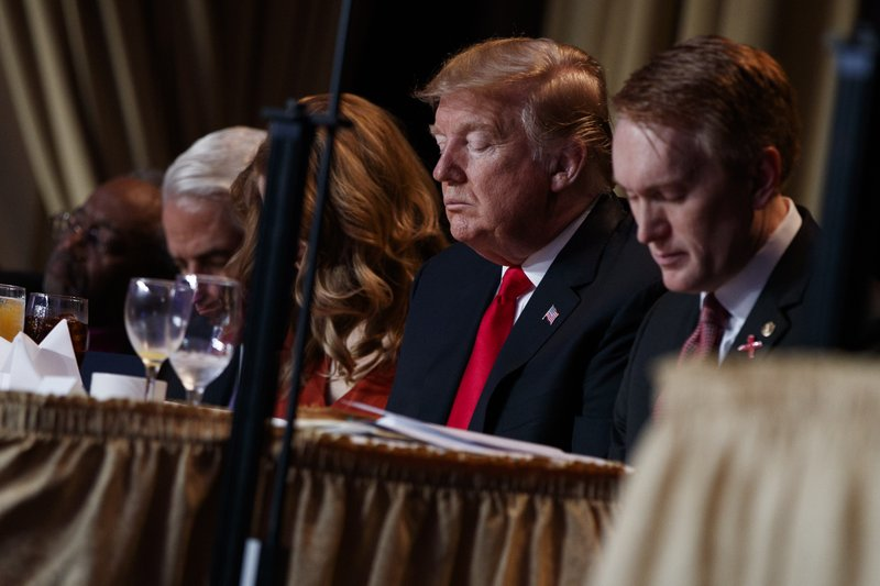 President Donald Trump prays during the National Prayer Breakfast, Thursday, Feb. 7, 2019, in Washington. (AP Photo/ Evan Vucci)