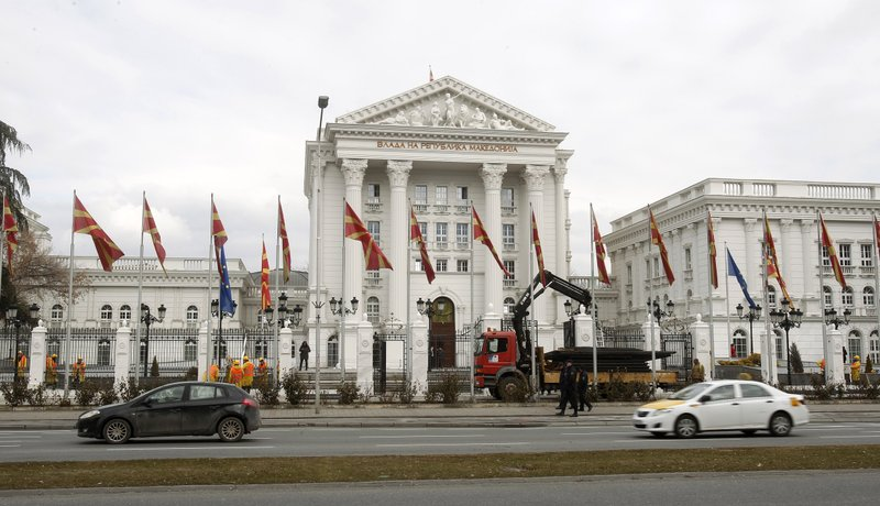 Workers dismantle metal fencing from the front of the Macedonia's Government in the capital Skopje, Thursday, Feb. (AP Photo/Boris Grdanoski)