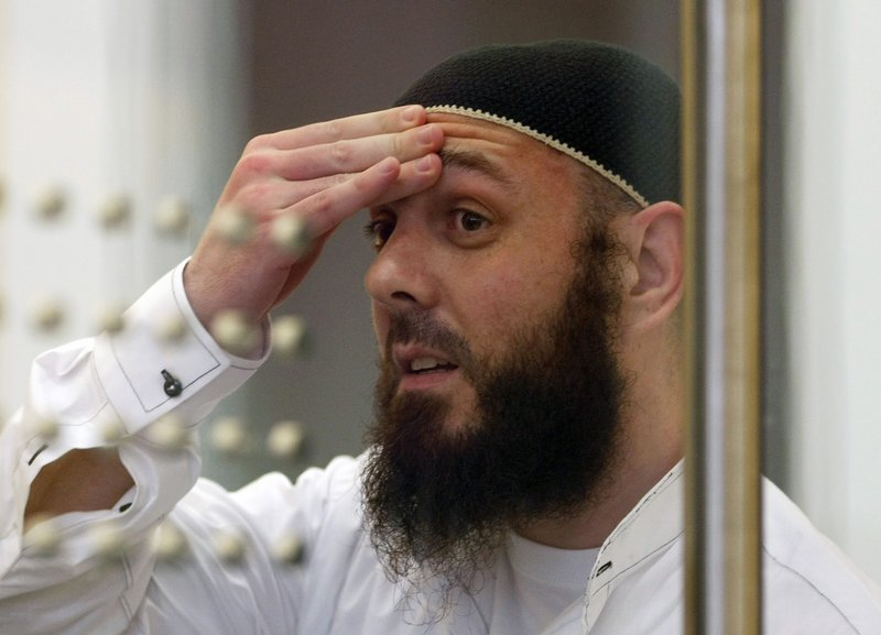 FILE - In this Tuesday Aug 11, 2009 file photo, defendant Adem Yilmaz reacts in a courtroom in Duesseldorf, western Germany. (Ina Fassbender/ Pool via AP)