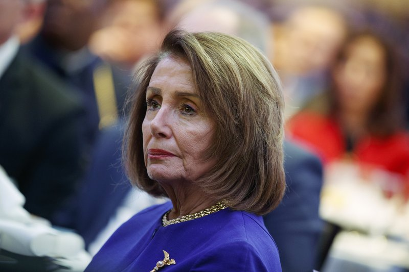 Speaker of the House Nancy Pelosi of Calif., listens as President Donald Trump speaks during the National Prayer Breakfast, Thursday, Feb. (AP Photo/ Evan Vucci)