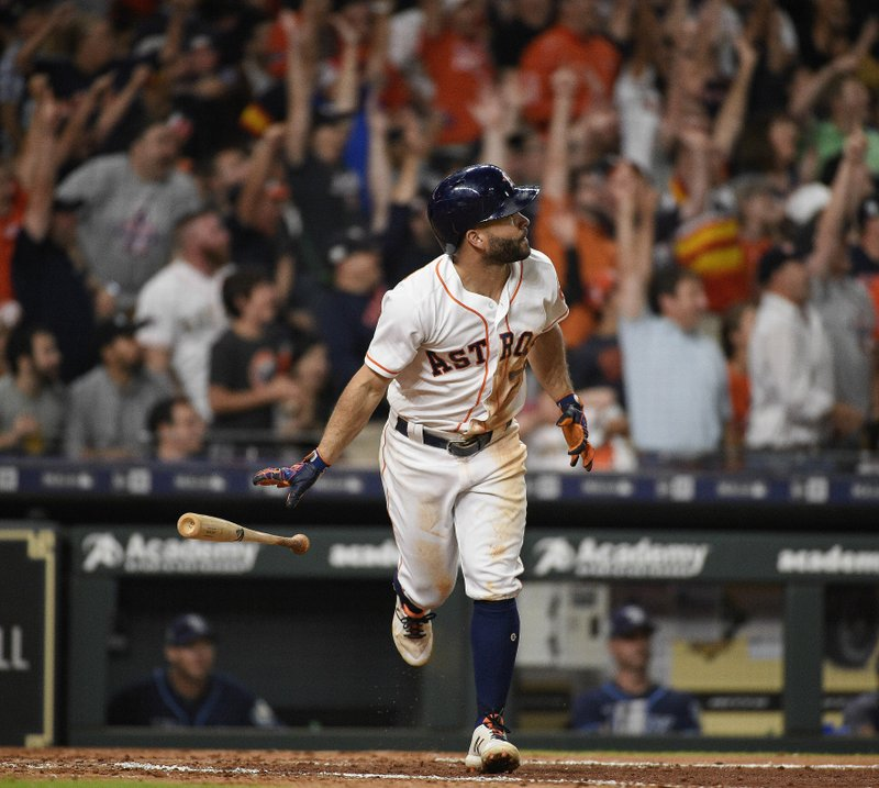 FILE - In this June 20, 2018, file photo, Houston Astros' Jose Altuve watches his solo home run off Tampa Bay Rays starting pitcher Nathan Eovaldi during the sixth inning of a baseball game, in Houston. (AP Photo/Eric Christian Smith, File)
