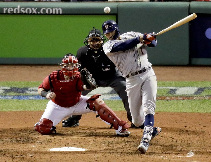 FILE - In this Oct. 13, 2018, file photo, Houston Astros' Carlos Correa watches his RBI-single against the Boston Red Sox during the sixth inning in Game 1 of a baseball American League Championship Series, in Boston. (AP Photo/Elise Amendola, File)