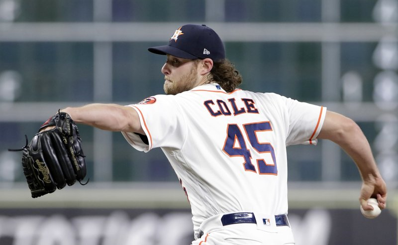 FILE - In this Sept. 2, 2018, file photo, Houston Astros starting pitcher Gerrit Cole (45) throws against the Los Angeles Angels during the first inning of a baseball game, in Houston. (AP Photo/Michael Wyke, File)