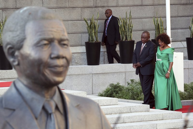 South African President, Cyril Ramaphosa, left, and speaker of the house, Baleka Mbete, right, arrive at parliament, behind a statue of Nelson Mandela, in Cape Town, South Africa, Thursday, Feb. (Mike Hutchings, Pool via AP)