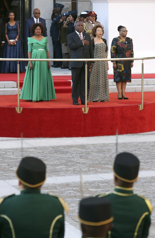 South African President, Cyril Ramaphosa, center, takes the national salute at parliament in Cape Town, South Africa, Thursday, Feb. (Mike Hutchings, Pool via AP)