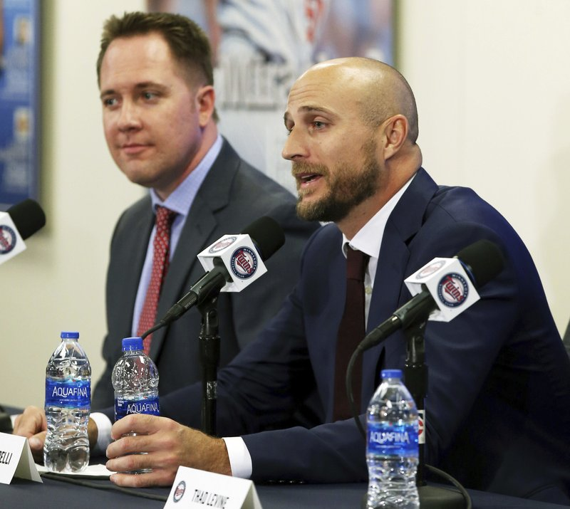 FILE - In this Oct. 25, 2018, file photo, new Minnesota Twins manager Rocco Baldelli, right, listens to a question after the team announced his hiring during a news conference in Minneapolis. (AP Photo/Jim Mone, File)