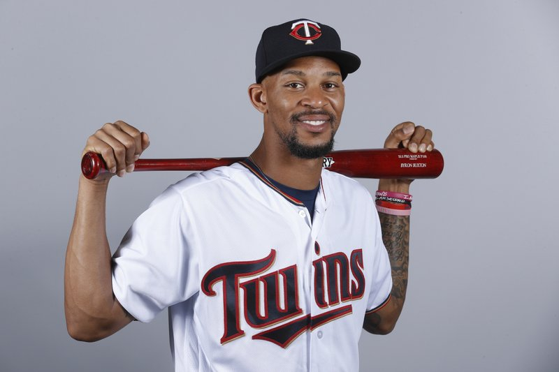 FILE - This Feb. 21, 2018, file photo, shows Byron Buxton of the Minnesota Twins baseball team. One of the first things on manager Rocco Baldelli's to-do list was to travel to the Atlanta area and the Dominican Republic to start getting to know Buxton and Miguel Sano. (AP Photo/John Minchillo, File)