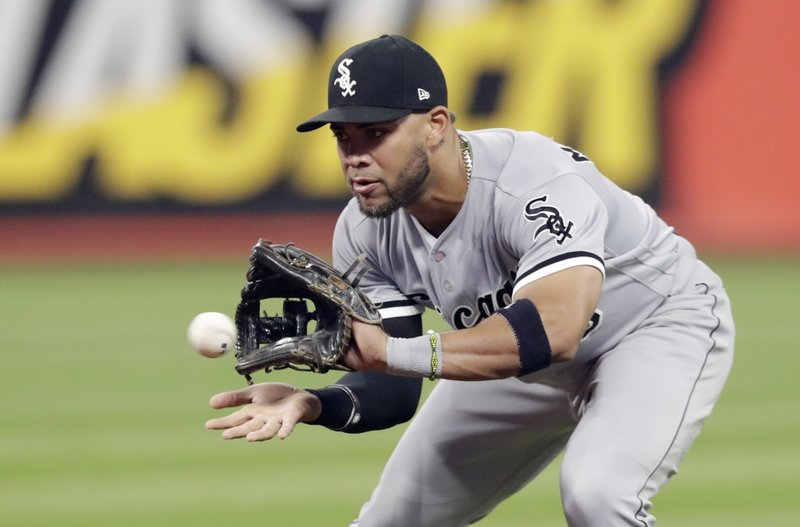 FILE - In this Sept. 19, 2018, file photo, Chicago White Sox's Yoan Moncada fields a ball hit by Cleveland Indians' Melky Cabrera during the fourth inning of a baseball game in Cleveland. (AP Photo/Tony Dejak, File)
