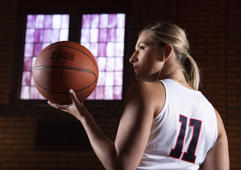 Gonzaga basketball player Laura Stockton poses for a photo in the Hutton Settlement auditorium, in Spokane, Wash. (Colin Mulvany/The Spokesman-Review via AP)