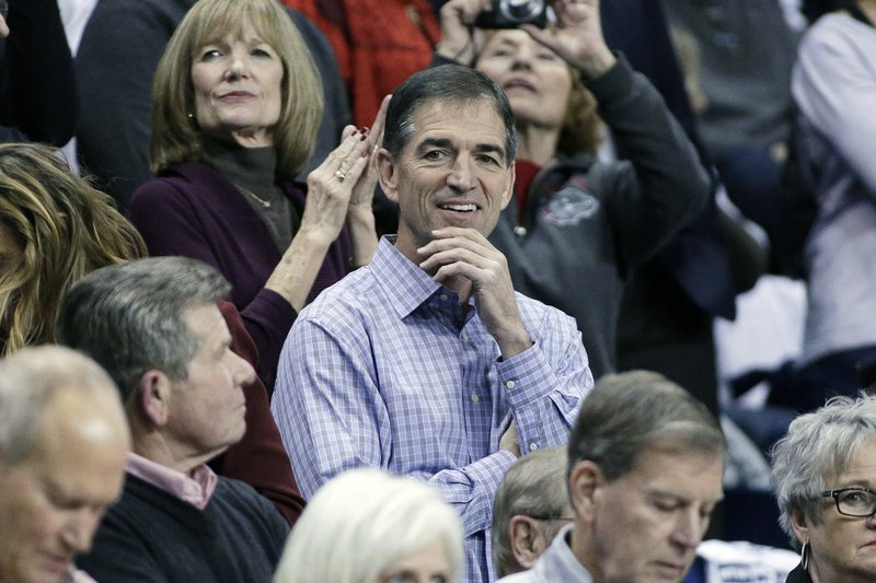 FILE - In this Dec. 7, 2016, file photo, retired NBA player and Gonzaga alumnus John Stockton, center, looks on before an NCAA college basketball game between Gonzaga and Washington in Spokane, Wash. (AP Photo/Young Kwak, File)