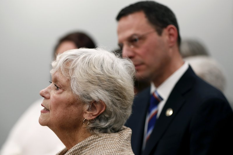 Cancer patient Judith Hays, left, speaks at a news conference with Pennsylvania Attorney General Josh Shapiro, right, about problems she has encountered due to the dispute between health insurance providers UPMC and Highmark Health, Thursday, Feb. (AP Photo/Keith Srakocic)