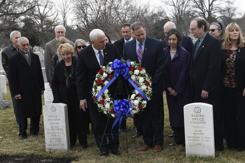 Vice President Mike Pence, front left, and NASA Administrator Jim Bridenstine, front right, place a wreath during the NASA Day of Remembrance ceremony at Arlington National Cemetery in Arlington, Va. (AP Photo/Susan Walsh)