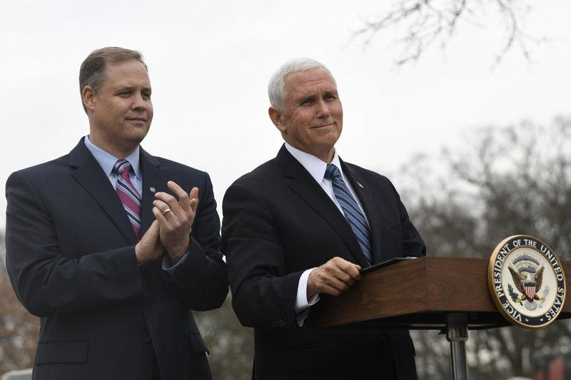 Vice President Mike Pence, right, is applauded by NASA Administrator Jim Bridenstine, left, during the NASA Day of Remembrance ceremony at Arlington National Cemetery in Arlington, Va. (AP Photo/Susan Walsh)