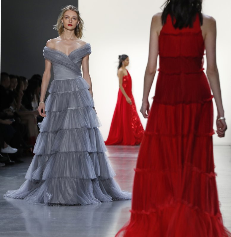 The latest fashion creation from Tadashi Shoji is modeled during New York Fashion Week, Thursday Feb. (AP Photo/Kathy Willens)