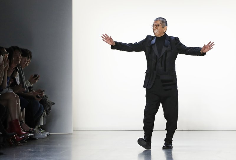 Designer Tadashi Shoji acknowledges his supporters after presenting his fashion collection during New York Fashion Week, Thursday Feb. (AP Photo/Kathy Willens)