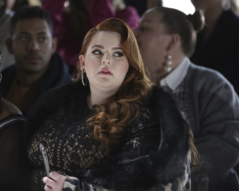 Model Tess Holliday attends the Tadashi Shoji Runway Show at Spring Studios during New York Fashion Week on Thursday, Feb. (Photo by Brent N. Clarke/Invision/AP)