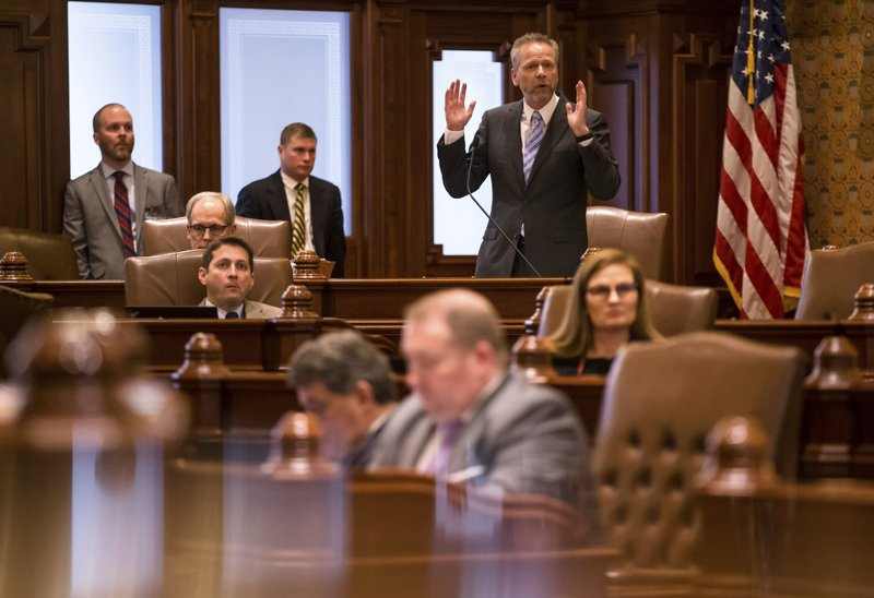 State Sen. Dale Righter, R-Mattoon, gives his remarks on his opposition to Senate Bill 1, a bill to raise the state's minimum wage to $15 an hour by 2025, during debate on the Senate floor at the Illinois State Capitol, Thursday, Feb. (Justin L. Fowler/The State Journal-Register via AP)