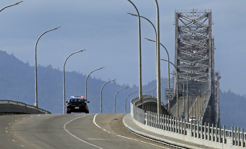 A California Highway Patrol officer drives on the closed Richmond-San Rafael bridge Thursday, Feb. 7, 2019, in Richmond, Calif. (AP Photo/Ben Margot