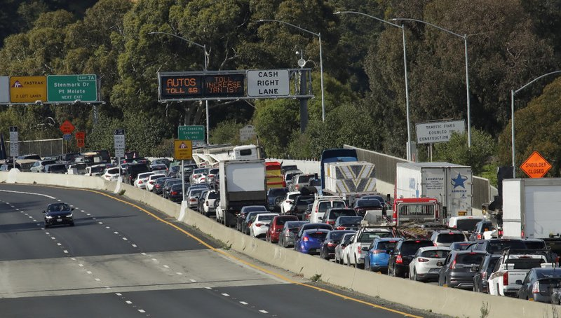 Standstill traffic on westbound Interstate 580 backs up due to the closure of the Richmond-San Rafael bridge Thursday, Feb. (AP Photo/Ben Margot)