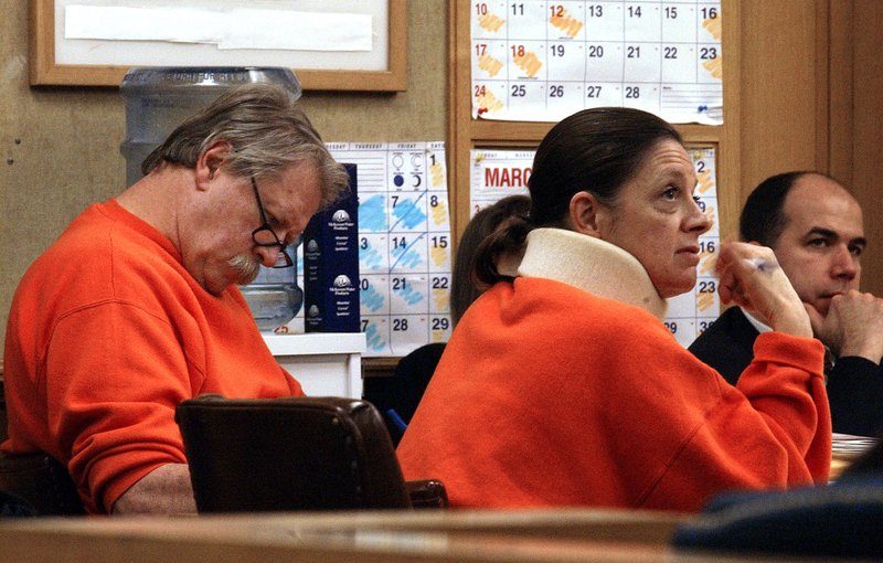 FILE - In this Jan. 14, 2002, file photo, Robert Noel and Marjorie Knoller, accused in the fatal dog mauling of neighbor Diane Whipple, attend a hearing asking for separate trials in San Francisco. (AP Photo/Jakub Mosur, File)