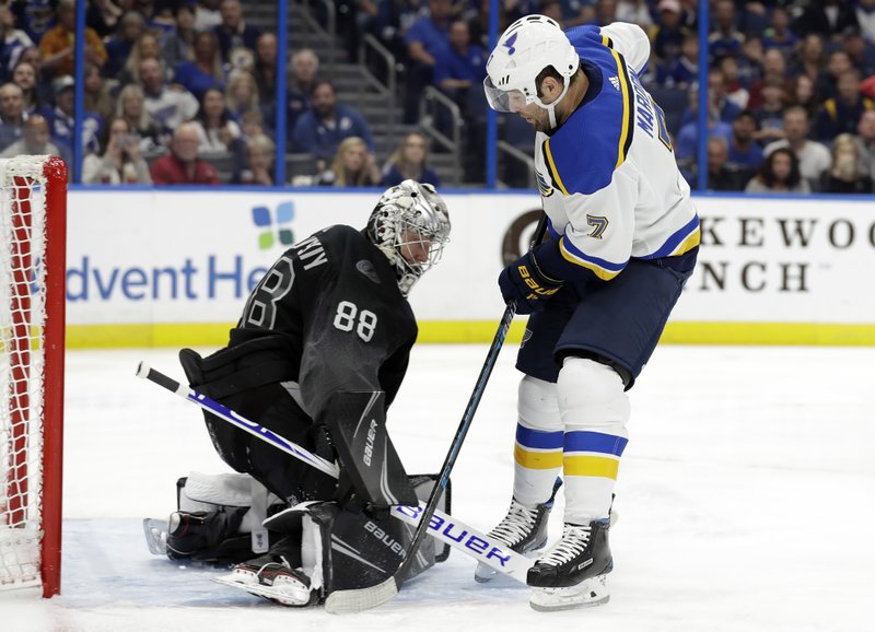 Tampa Bay Lightning goaltender Andrei Vasilevskiy (88) makes a save on a shot by St. Louis Blues left wing Pat Maroon (7) during the first period of an NHL hockey game Thursday, Feb. (AP Photo/Chris O'Meara)