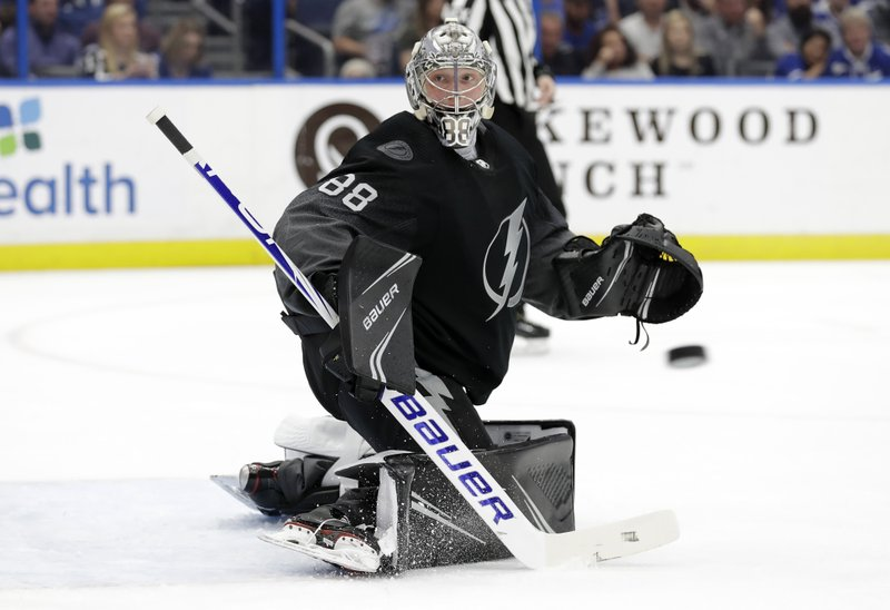 Tampa Bay Lightning goaltender Andrei Vasilevskiy makes a stick save on a shot by the St. Louis Blues during the first period of an NHL hockey game Thursday, Feb. (AP Photo/Chris O'Meara)