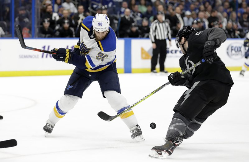 Tampa Bay Lightning center Tyler Johnson (9) steals the puck from St. Louis Blues center Ryan O'Reilly (90) during the first period of an NHL hockey game Thursday, Feb. (AP Photo/Chris O'Meara)