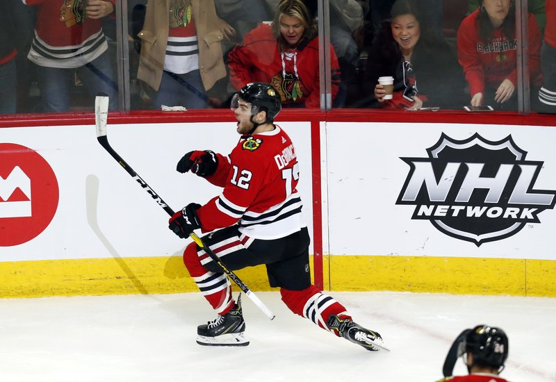 Chicago Blackhawks left wing Alex DeBrincat (12) celebrates after his goal against the Vancouver Canucks during the second period of an NHL hockey game Thursday, Feb. (AP Photo Nuccio DiNuzzo)