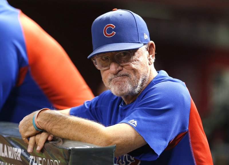 FILE - In this Sept. 18, 2018, file photo, Chicago Cubs manager Joe Maddon stands at the rail during the first inning of the team's baseball game against the Arizona Diamondbacks in Phoenix. (AP Photo/Rick Scuteri, File)