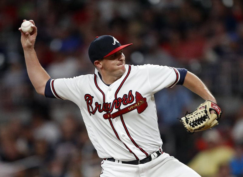 FILE - In this July 30, 2018, file photo, Atlanta Braves relief pitcher Brad Brach works in the eighth inning of a baseball game against the Miami Marlins Monday, July 30, 2018 in Atlanta. (AP Photo/John Bazemore, File)