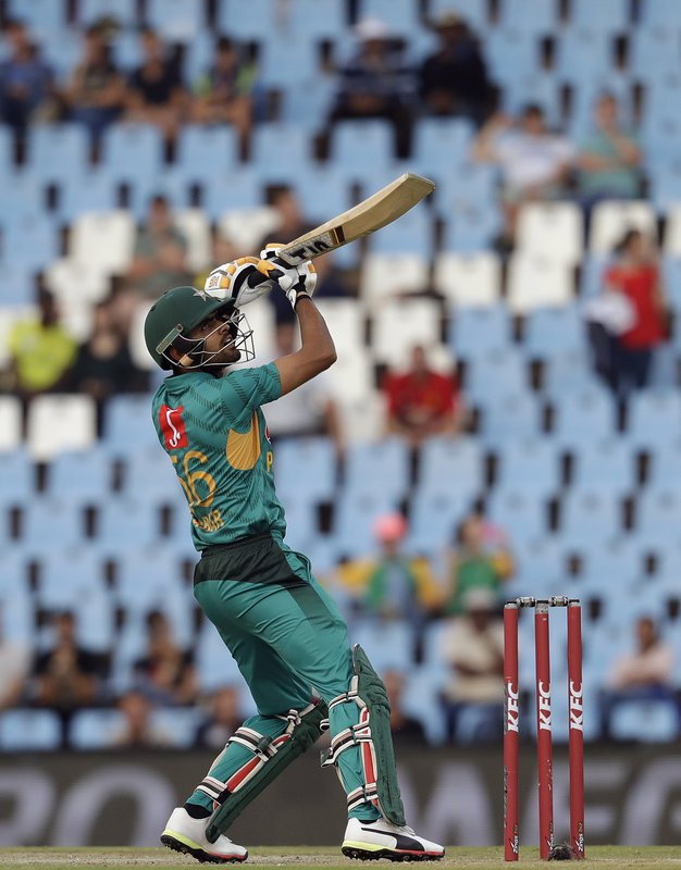 Pakistan's batsman Babar Azam watches his shot during the third T20 cricket match between South Africa and Pakistan at the Centurion Park in Pretoria, South Africa, Wednesday, Feb. (AP Photo/Themba Hadebe)