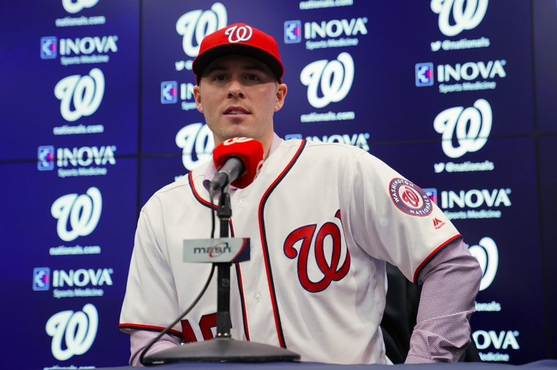 FILE  - In this Dec. 7, 2018, file photo, Washington Nationals new pitcher Patrick Corbin answers questions from members of the media during a baseball news conference at Nationals Park in Washington. (AP Photo/Pablo Martinez Monsivais, File)