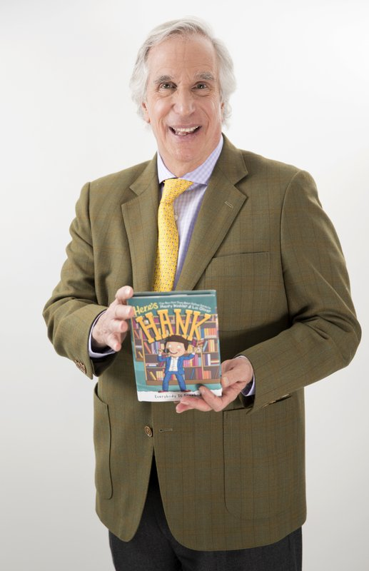In this Feb. 5, 2019 photo, actor and author Henry Winkler holding his latest book in the