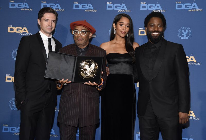 Spike Lee poses, second left, in the press room holding a plaque for his nomination for outstanding directorial achievement in feature film for