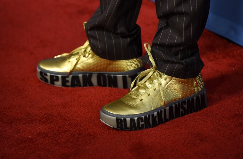 Spike Lee arrives wearing shoes that read