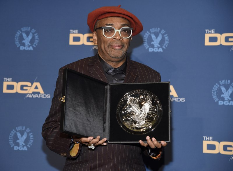 Spike Lee poses in the press room with a plaque for his nomination for outstanding directorial achievement in feature film for