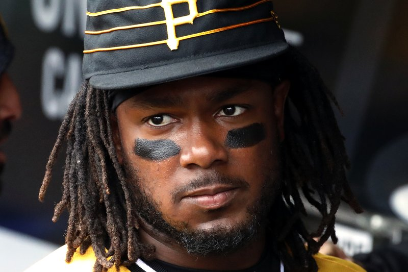 FILE - In this April 8, 2018, file photo, Pittsburgh Pirates' Josh Bell standing in the dugout before the team's baseball game against the Cincinnati Reds, in Pittsburgh. (AP Photo/Gene J. Puskar/File)