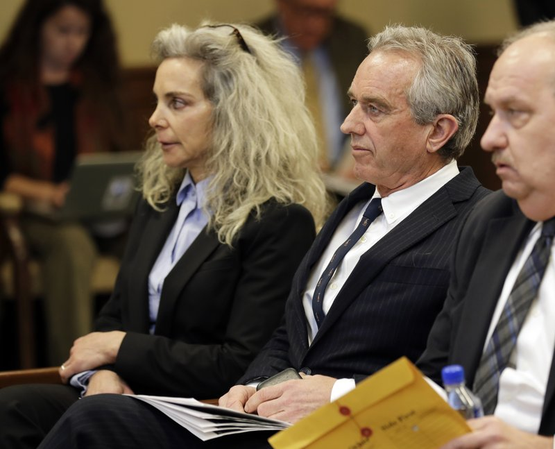 Robert Kennedy Jr., center, and Dr. Toni Bark, left, wait to testify Friday, Feb. 8, 2019, during a public hearing before the House Health Care & Wellness Committee at the Capitol in Olympia, Wash. (AP Photo/Ted S. Warren)