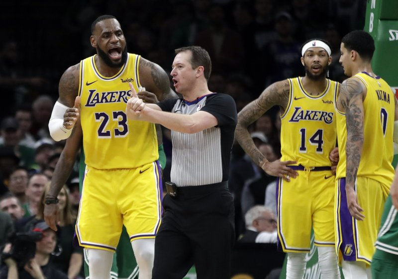 Los Angeles Lakers forward LeBron James (23) argues a call with the referee as Lakers forwards Brandon Ingram (14) and Kyle Kuzma (0) talk to each other in the fourth quarter of an NBA basketball game against the Boston Celtics, Thursday, Feb. (AP Photo/Elise Amendola)